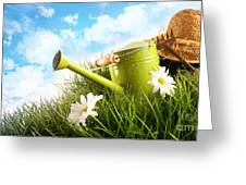 Water Can And Straw Hat Laying In Grass Greeting Card by Sandra Cunningham