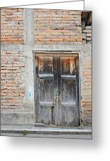 Weathered Wood Door In An Adobe Brick Wall Greeting Card