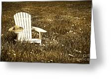 White Chair With Straw Hat In A Field Greeting Card