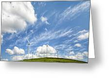 Wind Turbines On A Hill Under A Blue Sky Greeting Card