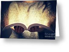 Woman Holding An Open Book Bursting With Light. Greeting Card