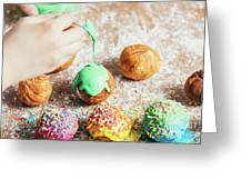 Woman's Hand Coating A Donut With Green Frosting. Greeting Card