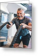Senior Man Exercising With Ropes At The Gym. Greeting Card