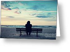 Man In Hood Sitting On A Lonely Bench On The Beach Greeting Card