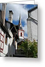 old historic church spire and houses in Ediger Germany Greeting Card