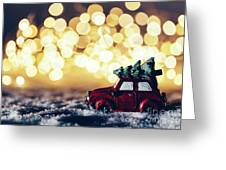 Red Car With Christmas Tree Driving Through Snow Greeting Card