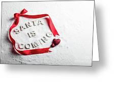 Santa Is Coming Text And Red Ribbon Greeting Card