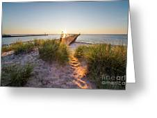 Sunset Over Dunes And Pier Greeting Card