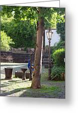 tree lamp and old water pump in Cochem Germany Greeting Card