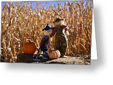 Two Cute Scarecrows With Pumpkins In The Dry Corn Field Greeting Card