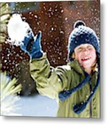 A Boy Throws A Snowball While Playing Metal Print
