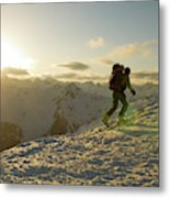 A Man Backcountry Skiing At Sunset Metal Print