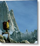 A Man Backpacks In Front Of Fitz Roy Metal Print