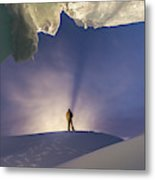 A Man Stands At The Entrance Of An Ice Metal Print