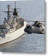 A Royal Navy Merlin Helicopter Passes Over Hms Cumberland Metal Print