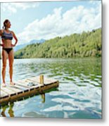 A Woman Is Standing On A Jetty Metal Print