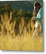 A Young Man Fly-fishing At Sunset Metal Print