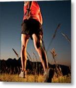 A Young Woman Runs Through A Grassy Metal Print