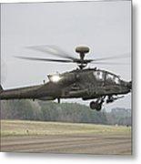 An Ah-64 Apache Helicopter In Midair Metal Print