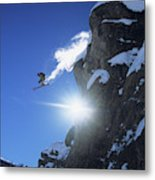 An Extreme Skier Jumps Off A Snowy Metal Print
