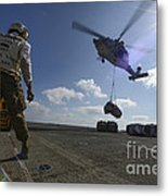 An Mh-60s Sea Hawk Helicopter Lowers Metal Print