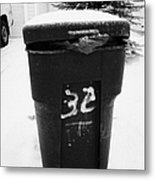 bag sticking out of litter waste bin covered in snow outside house in Saskatoon Saskatchewan Canada Metal Print by Joe Fox