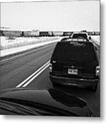 cars waiting on train crossing trans-canada highway in winter outside Yorkton Saskatchewan Canada Metal Print by Joe Fox