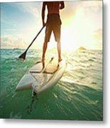 Caucasian Man On Paddle Board In Ocean Metal Print