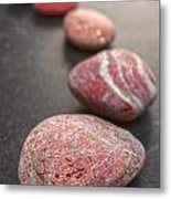 Curving Line Of Red And Grey Pebbles On Dark Background Metal Print by Colin and Linda McKie