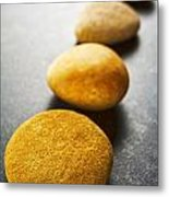 Diagonal Line Of Brown Pebbles On Dark Background Metal Print by Colin and Linda McKie