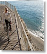 Elevated Perspective Of Woman Riding Metal Print