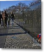 Flowers Left At The Vietnam War Memorial Metal Print