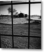 looking out through door window to snow covered scene in small rural village of Forget Saskatchewan  Metal Print