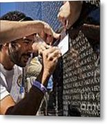 Man Getting A Rubbing Of Fallen Soldier's Name At The Vietnam War Memorial Metal Print