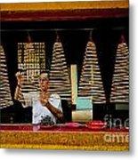 Man Lighting Incense In Chinese Temple Vietnam Metal Print