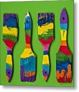 Multicolored Paint Brushes On Green Background Metal Print