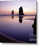 Needles Silhouetted Cannon Beach Oregon Metal Print