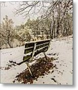 Park Bench In The Snow Covered Park Overlooking Lake Metal Print