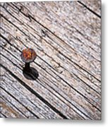 Rusty Nail In An Old Wooden Board Metal Print