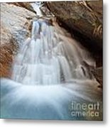 Small Waterfall Casdcading Over Rocks In Blue Pond Metal Print