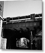 train going over railway bridge elevated section of track southwark London England UK Metal Print