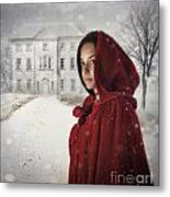 Young Woman Wearing Hooded Cape In Snowy Winter Scene Metal Print
