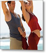 A Man And Woman Practicing Yoga Metal Print
