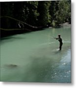 A Man Casts In A River Wearing Waders Metal Print