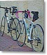 2 Bikes Against Wall Metal Print