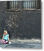 Girl Sitting On Ground Next To Brick Wall Metal Print
