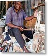 Kenya. December 10th. A Man Carving Figures In Wood. Metal Print