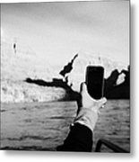 man taking photos with smartphone during boat ride along the colorado river in the grand canyon Ariz Metal Print