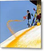 Man Throwing Orange Paint On Boudhanath Stupa Metal Print