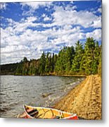 Red Canoe On Lake Shore Metal Print by Elena Elisseeva